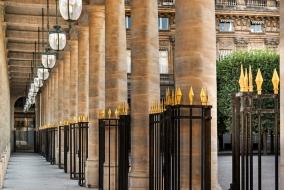 Under the arcade of the Palais Royal